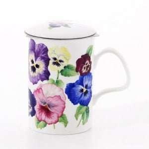 taza con filtro para el té flores variadas